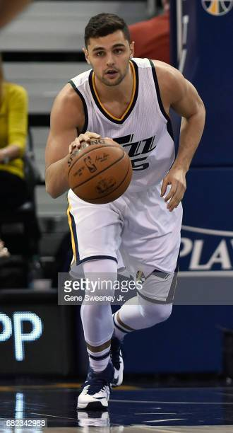 Raul Neto of the Utah Jazz brings the ball up court against the Golden State Warriors in Game Four of the Western Conference Semifinals during the...