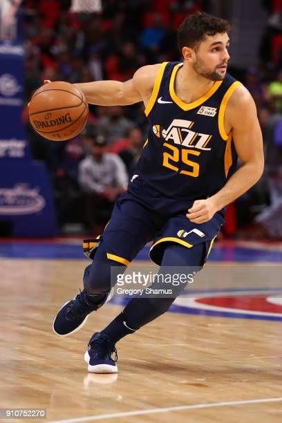 Raul Neto of the Utah Jazz brings the ball up court while playing the Detroit Pistons at Little Caesars Arena on January 24 2018 in Detroit Michigan...