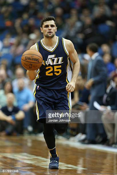 Raul Neto of the Utah Jazz drives to the basket against the Minnesota Timberwolves during the game on March 26 2016 at Target Center in Minneapolis...