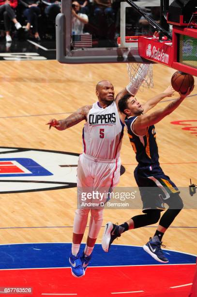 Raul Neto of the Utah Jazz goes up for a lay up against Marreese Speights of the LA Clippers during a game on March 25 2017 at STAPLES Center in Los...