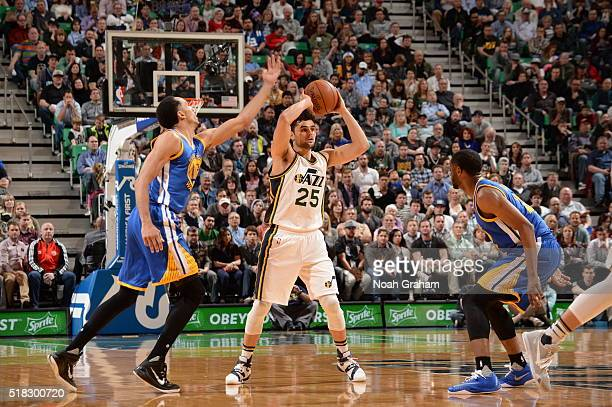 Raul Neto of the Utah Jazz handles the ball against the Golden State Warriors on March 30 2016 at vivintSmartHome Arena in Salt Lake City Utah NOTE...