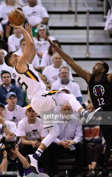 Raul Neto of the Utah Jazz tries for the basket while being defended by Luc Mbah a Moute of the Los Angeles Clippers in the second half of the 9893...
