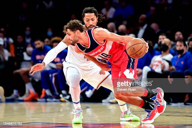 Raul Neto of the Washington Wizards is defended by Derrick Rose of the New York Knicks during a preseason game at Madison Square Garden on October...