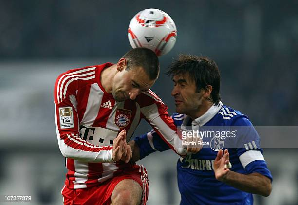 Raul of Schalke and Diego Contento of Bayern Muenchen head for the ball during the Bundesliga match between FC Schalke 04 and Bayern Muenchen at...
