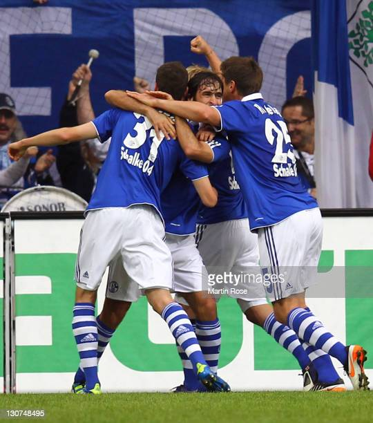 Raul of Schalke celebrate with his team mates after he scores his team's opening goal during the Bundesliga match between FC Schalke 04 and 1899...