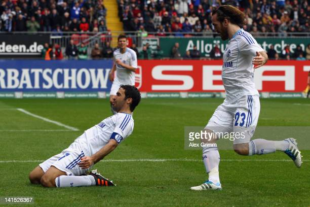 Raul of Schalke celebrates his team's third goal with team mate Christian Fuchs during the Bundesliga match between 1 FC Kaiserslautern and FC...