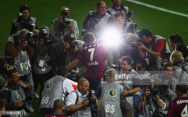 Raul of Schalke celebrates with a spanish flag after winning the DFB Cup final match between MSV Duisburg and FC Schalke 04 at Olympic Stadium on May...