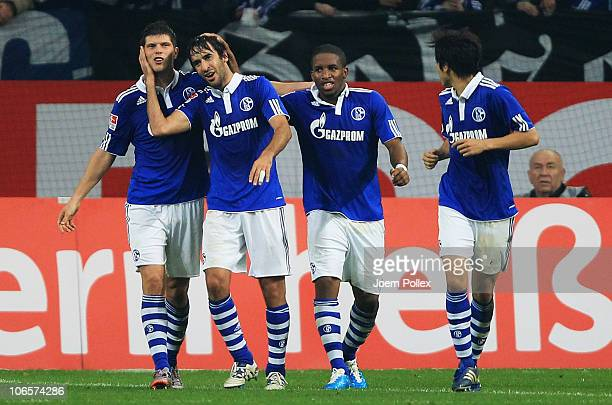 Raul of Schalke celebrates with his team mates after scoring his team's third goal during the Bundesliga match between FC Schalke 04 and FC St Pauli...