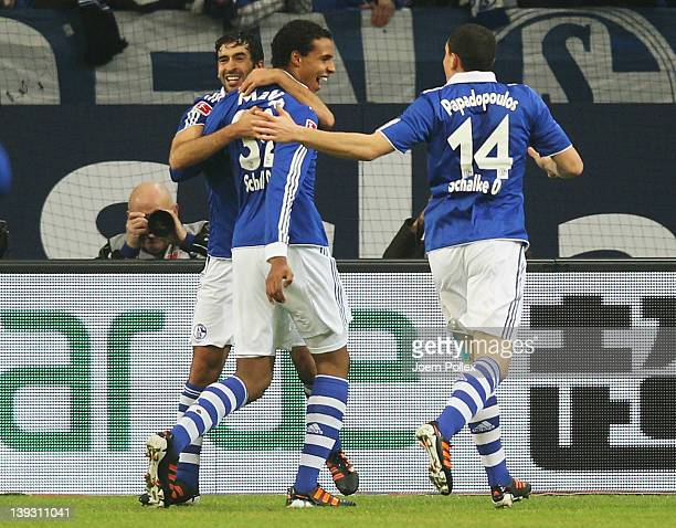 Raul of Schalke celebrates with his team mates after scoring his team's first goal during the Bundesliga match between FC Schalke 04 and VfL...