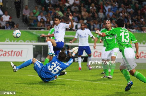 Raul of Schalke scores his team's first goal during the Bundesliga match between VfL Wolfsburg and FC Schalke 04 at Volkswagen Arena on September 11...