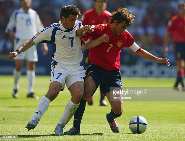 Raul of Spain battles with Theodoros Zagorakis of Greece during the UEFA Euro 2004 Group A match between Greece and Spain at the Estadio do Bessa Sec...