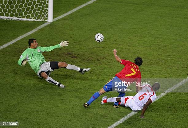 Raul of Spain scores his team equaliser past Goalkeeper Ali Boumnijel of Tunisia during the FIFA World Cup Germany 2006 Group H match between Spain...