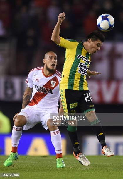 Raul Poclaba of Aldosivi heads the ball next to Jonathan Maidana of River Plate during a match between River Plate and Aldosivi as part of Torneo...