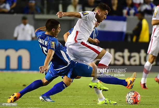 Raul Renderos of El Salvador vies for the ball with Jonathan Osorio of Canada during their 2015 Concacaf Gold Cup match in Carson California on July...