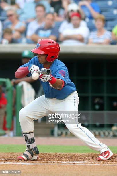 Raul Rivas of the Threshers lays down a bunt for a hit during the Florida State League game between the Daytona Tortugas and the Clearwater Threshers...