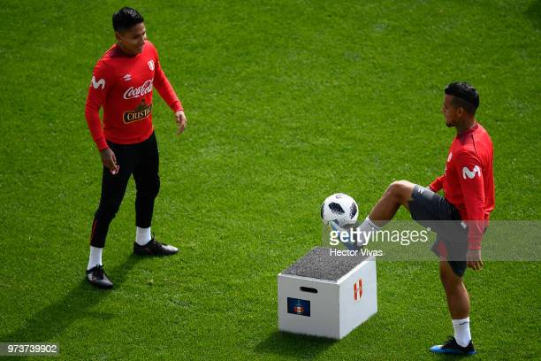 Raul Ruidiaz and Miguel Trauco of Peru make the ball bounce on the plinth during a training session at Arena Khimki on June 12 2018 in Khimki Russia