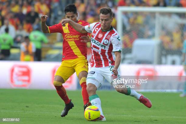 Raul Ruidiaz of Morelia vies for the ball with Fernando Gonzalez of Necaxa during their Mexican Clausura tournament football match at the Morelos...