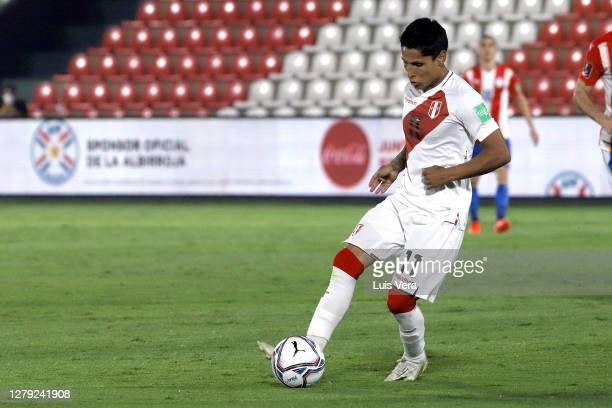 Raul Ruidiaz of Peru drives the ball during a match between Paraguay and Peru as part of South American Qualifiers for Qatar 2022 at Estadio...