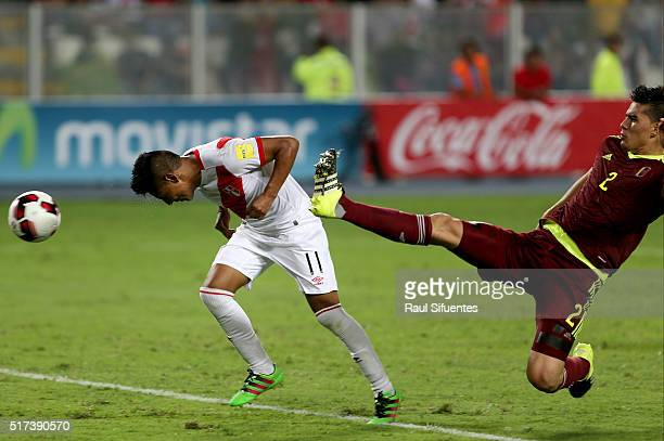 Raul Ruidiaz of Peru heads the ball to score the second goal of his team against Venezuela during a match between Peru and Venezuela as part of FIFA...