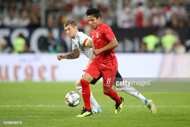 Raul Ruidiaz of Peru is challanged by Toni Kroos of Germany during the International Friendly match between Germany and Peru at Rhein-Neckar-Arena on...