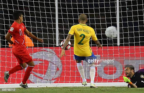 Raul Ruidiaz of Peru scores despite the defense of Daniel Alves of Brazil and Alisson Becker in the second half during the 2016 Copa America...