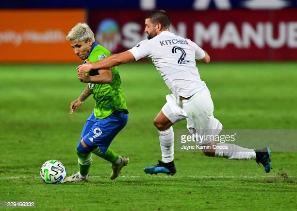 Raul Ruidiaz of Seattle Sounders and Perry Kitchen of Los Angeles Galaxy battle for the ball in the first half of the game at Dignity Health Sports...