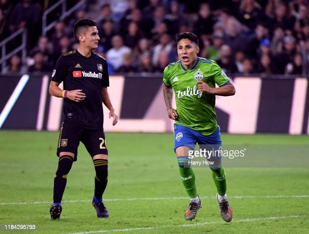 Raul Ruidiaz of Seattle Sounders celebrates his goal in front of Eduard Atuesta of Los Angeles FC to take a 3-1 lead during the second half during...