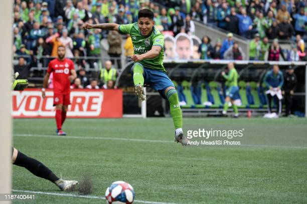 Raul Ruidiaz of the Seattle Sounders FC watches his shot roll wide during a game between Toronto FC and Seattle Sounders FC at CenturyLink Field on...
