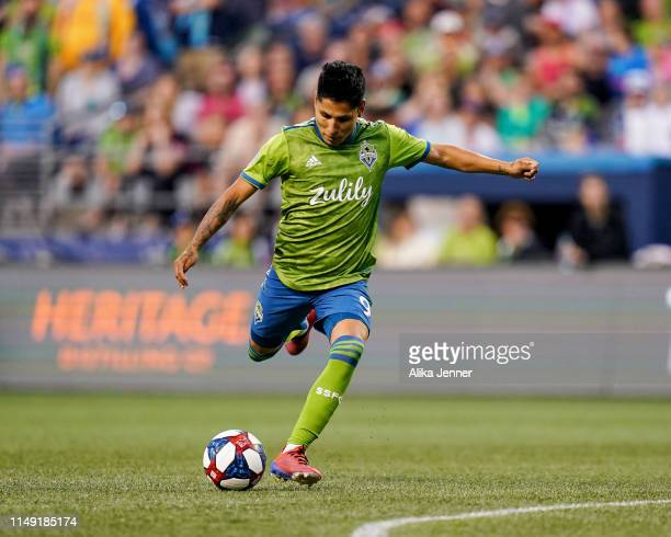 Raul Ruidiaz of the Seattle Sounders takes a shot on goal during the match against the Houston Dynamo at CenturyLink Field on May 11, 2019 in...