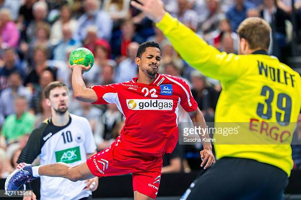 Raul Santos of Austria challenges goalkeeper Andreas Wolff of Germany during the European Handball Championship 2016 Qualifier between Germany and...