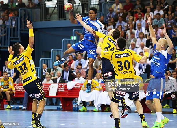 Raul Santos of Gummersbach is challenged by Alexander Petersson Patrick Groetzki and Gedeon Guardiola Villaplana of RheinNeckar Loewen during the DKB...