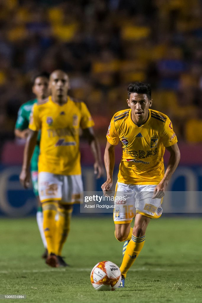 9e305e65731 Raul Torres of Tigres drives the ball during the 1st round match ...