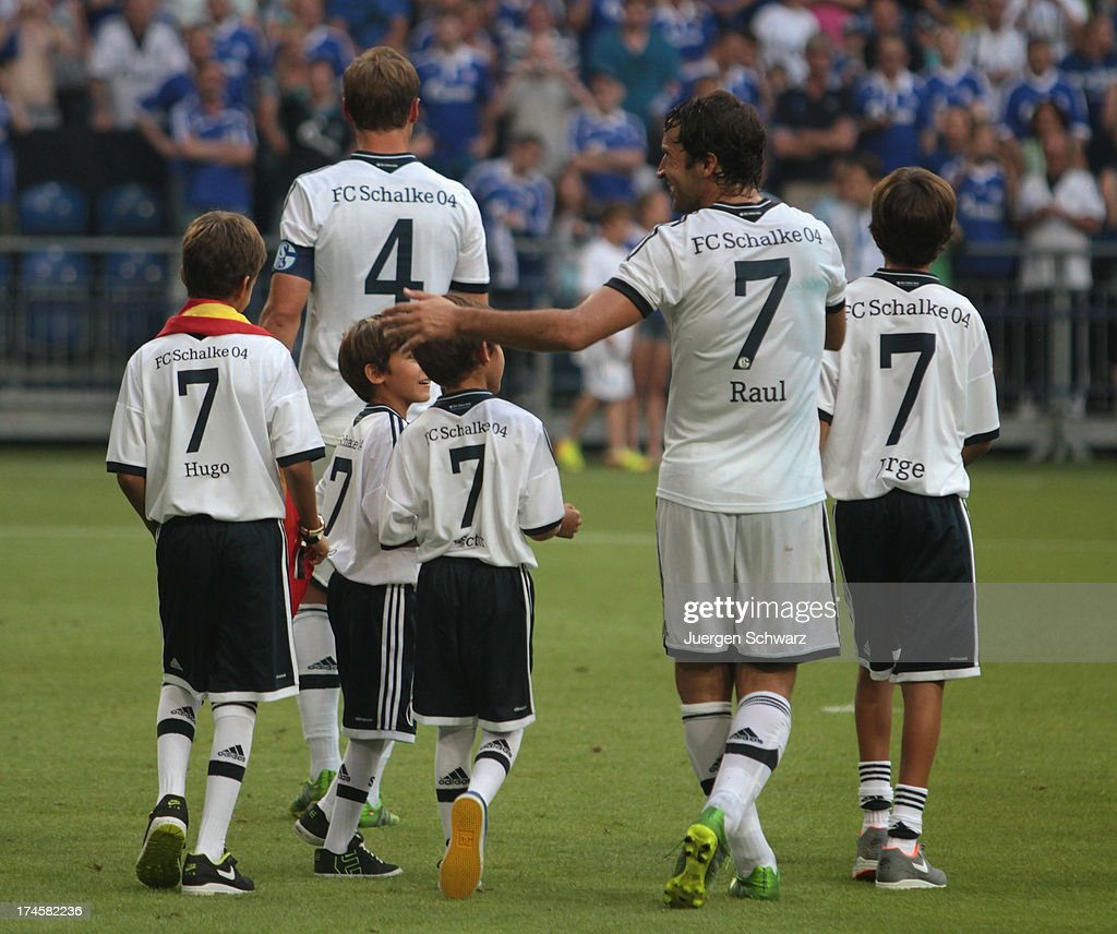 Raul walks with his sons on the pitch after his farewell match between Schalke 04 and Al-Sadd Sports Club Katar at Veltins Arena on July 27, 2013 in Gelsenkirchen, Germany.
