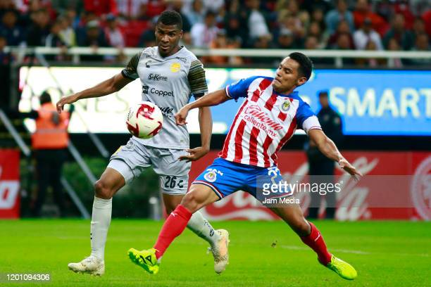 Raul Zuniga of Dorados fights for the ball with Jose Vazquez of Chivas during a match between Chivas and Dorados as part of the Copa MX 201920 at...