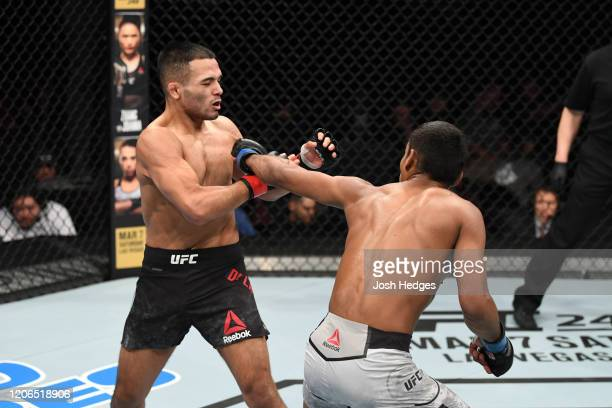 Raulian Paiva of Brazil punches Mark De La Rosa in their flyweight bout during the UFC Fight Night event at Santa Ana Star Center on February 15,...