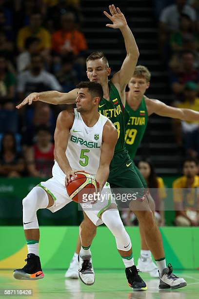 Raulzinho Neto of Brazil moves the ball during a Men's preliminary round basketball game between Brazil and Lithuania on Day 2 of the Rio 2016...