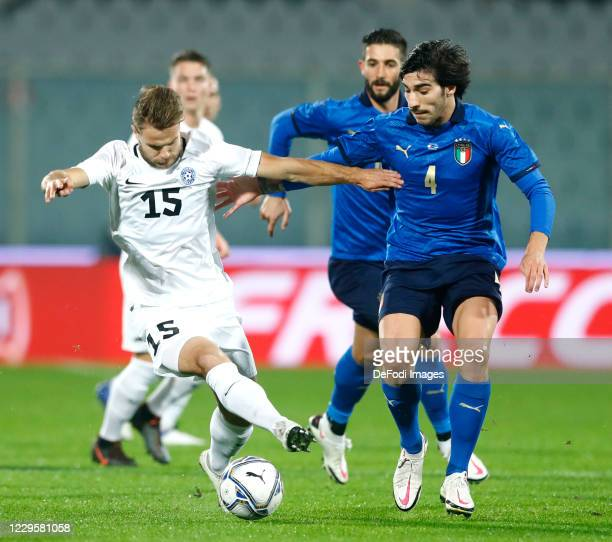Rauno Sappinen of Estonia and Sandro Tonali of Italy battle for the ball during the International Friendly match between Italy and Estonia at Stadio...