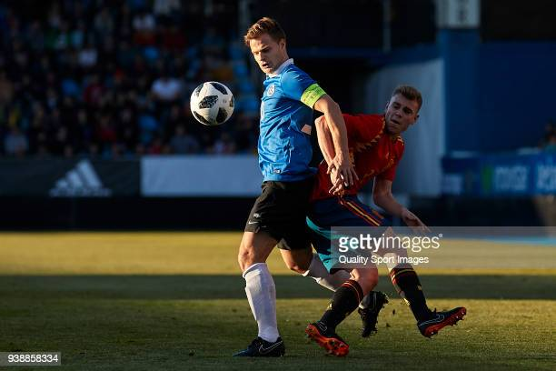 Rauno Sappinen of Estonia U21 is challenged by Toni Lato of Spain U21 during the 2019 UEFA Under 21 qualification match between Spain U21 and Estonia...