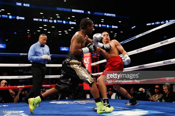 Rau'shee Warren connects with Jovany Fuentes during their Bantamweight bout at Barclays Center on June 22 2013 in the Brooklyn borough of New York...
