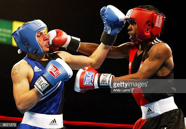 Rau'shee Warren of Cincinnati Ohio lands a punch in his light flyweight match against Diego Hurtado of Sparks Nevada during the 2004 Olympic BoxOffs...