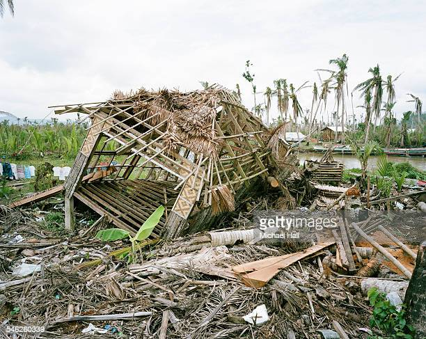 ravaged thatched house after typhoon - destruction stock pictures, royalty-free photos & images