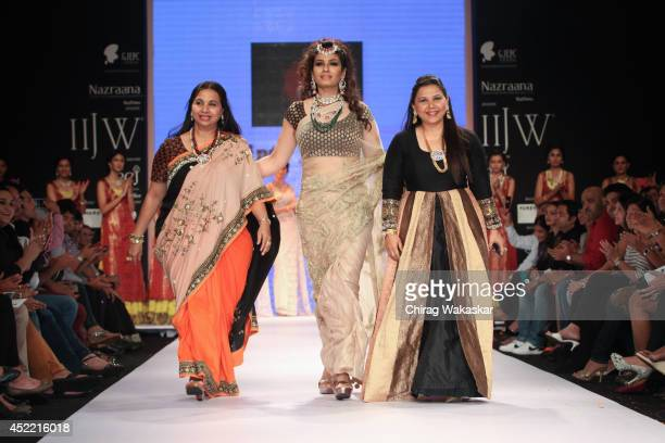 Raveena Tandon walks the runway at the Dipti Amisha show during day 2 of the India International Jewellery Week 2014 at grand Hyatt on July 15 2014...