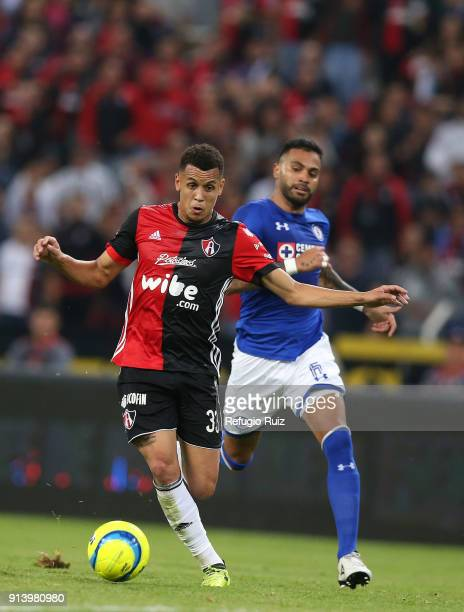 Ravel Morrison fights for the ball with Martin Rodriguez of Cruz Azul during the 5th round match between Atlas and Cruz Azul as part of the Torneo...