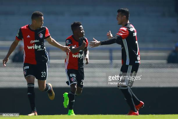 Ravel Morrison of Atlas celebrates with teammates Clifford Aboagye and Daniel Arreola after scoring the first goal of his team during the second...