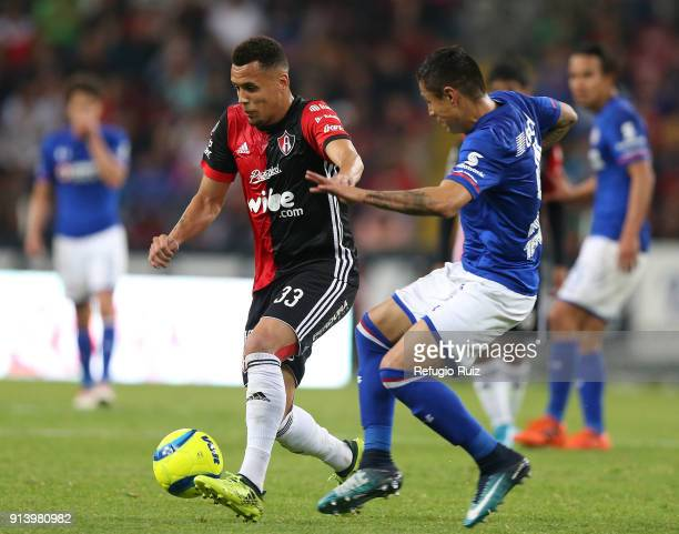 Ravel Morrison of Atlas fights for the ball with Julio Cesar Dominguez of Cruz Azul during the 5th round match between Atlas and Cruz Azul as part of...