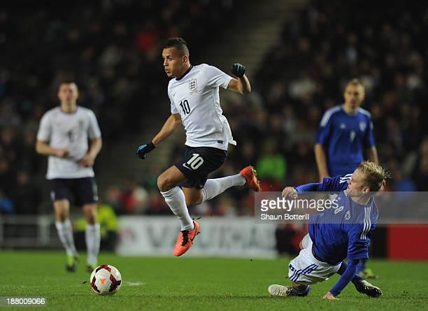 Ravel Morrison of England avoids a challenge by Kalle Kauppi of Finland during the 2015 UEFA European Under 21 Championships Qualifier Group 1 match...