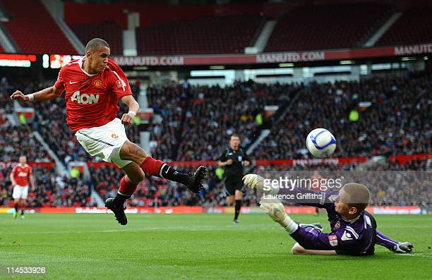 Ravel Morrison of Manchester United has his shot saved by George Long of Sheffield United during the FA Youth Cup Final 2nd Leg match between...