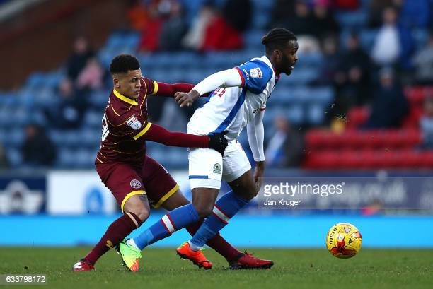 Ravel Morrison of Queens Park Rangers battles with Hope Akpan of Blackburn Rovers during the Sky Bet Championship match between Blackburn Rovers and...