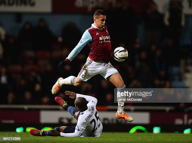 Ravel Morrison of West Ham United battles with Fernandinho of Manchester City during the Capital One Cup SemiFinal Second Leg match between West Ham...