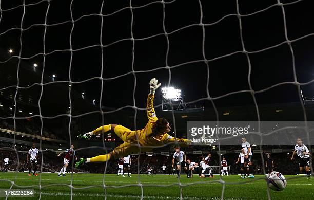 Ravel Morrison of West Ham United shoots past goalkeeper Scott Brown of Cheltenham Town to score their second goal during the Capital One Cup second...